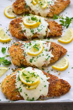 Chicken cutlets that are coated with Romano cheese, extra crispy panko bread crumbs, fresh oregano and lemon zest then they are pan fried in olive oil to a perfectly golden brown color and they're finished off in the oven with mozzarella and provolone cheese melted on top.