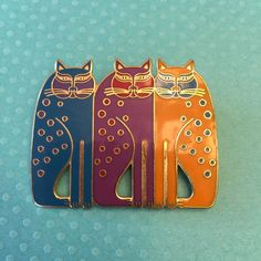 A personal favorite from my Etsy shop https://www.etsy.com/listing/478298161/vintage-siamese-cats-laurel-burch-signed