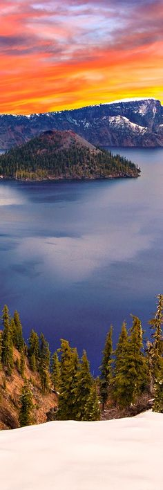 17. Crater Lake Crater Lake (Klamath: giiwas) is a caldera lake in south-central Oregon in the western United States. It is the main feature of Crater Lake National Park and is famous for its deep blue color and water clarity. The lake partly fills a nearly 2,148-foot (655 m)-deep caldera that was formed around 7,700 (± …