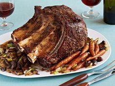 Anne Burrell's Standing Rib Roast Recipe. Uses 8 pound rib roast, cayenne pepper, fresh rosemary, garlic, olive oil, kosher salt, onion, baby carrots, celery, cremini mushrooms, red wine, chicken stock and bay leaves. (Christmas Recipes)