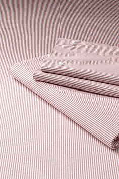 I love crisp sheets...hate t-shirt sheets.  Love these - Stripe Oxford Sheet Set or Pillowcase from Lands' End