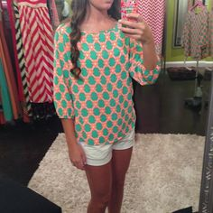 Love the print on this coral and mint top!