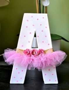 Wooden letter decorated with a tutu.