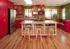 Awesome kitchen interior design in red color.