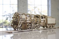 Ugears Locomotive. You can find it at kooqie #Ugears #kooqie #cookie #locomotive #puzzle #3dpuzzle #train #intercity #railway #interail