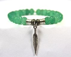 "the Native Indian Feather Charm is known to express ones ""Courage, Conviction and Strength"" ...Green Jade Semi-Precious Stone bracelet with stylish Native Indian Feather Charm"