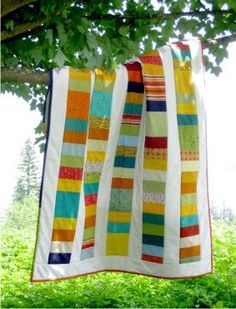 Awww...a summer breeze...a colorful quilt...no cell phone...and a very good book!