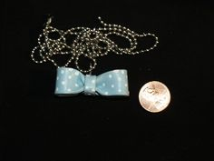 Blue with white polka dots - polymer clay bow charm/pendant.