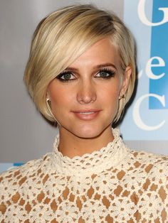 Ashlee Simpson | Long, side swept bangs add softness to Ashlee Simpson's chin-length bob. via @stylelist