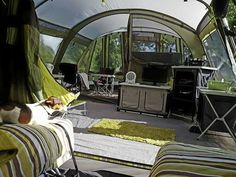 This has got to be one of the nicest camping tent interiors we've ever seen! Love the matching colours, rug, furniture etc. Feels more like a conservatory than a tent! Outwell Vermont LP. #camping #tents #glamping #mykindofcamping