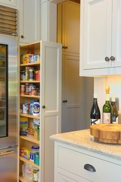 If you're remodeling or have an old stye broom cabinet in the kitchen, this one's for you. Streamlined top to bottom Rolling Pantry.