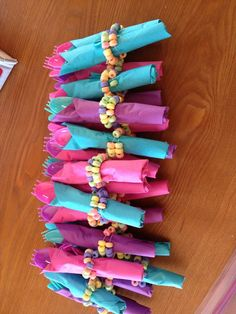 silverware wrapped in candy bracelets for candyland party