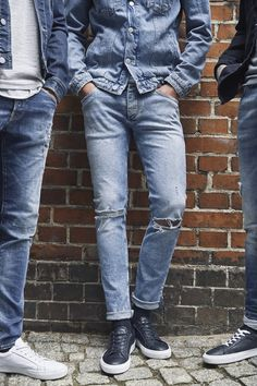 Rolled-up destroyed denim with ripped knees paired with a blue denim jack  and black