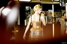 Backstage at Fashion Week (the link shows the sources, but I'm not sure which photo matches up to which photographer)