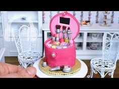 This is the most complicated mini cake I have made to date. It's a miniature makeup box complete with tiny edible lipsticks, nail polish, blusher, eye shadow. Mini Makeup, Makeup Box, Tiny Cooking, Make Up Cake, Mini Foods, Diy Cake, Birthday Candles, Snow Globes, Fondant
