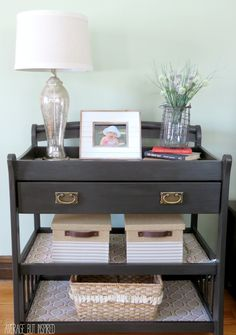 Repurpose an old changing table into a console table!  A little paint and some new hardware goes a long way!