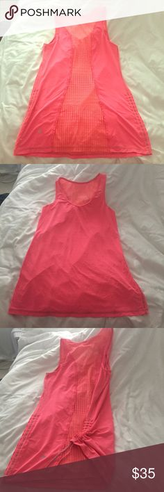 Lululemon tank Lululemon tank size 6 with silverescent technology. Only worn a couple times. EXCELLENT condition. Has bungees on both sides to cinch up or leave it long. Cool vent mesh along the entire back with cute ruffle detail. NO TRADES lululemon athletica Tops