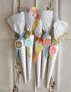 Party favors. I brought the fabric in Paris and the cones are covered in vintage paper napkins tied up with my absolute favorite Italian cotton ribbon from Carta, Inc.