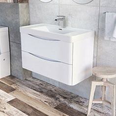 The Eaton white gloss is a lovely modern range perfect to brighten up any bathroom. The range is available in Vanity Units, Tall Storage Cabinets, WC Units and Bath Panels. The vanity units are available in floor standing or wall hung. White Bathroom Storage, Bathroom Sink Units, White Bathroom Furniture, Bathroom Basin, Simple Bathroom, Bathroom Ideas, Basin Vanity Unit, Basin Sink, Wall Hung Vanity