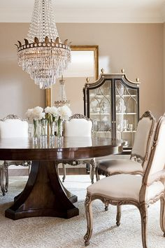 Villiers Dining Table, Simone Side Chairs, Saville Cabinet, and Campanile Mirror from Collection Ten by Ebanista. A very gorgeous formal dining room.