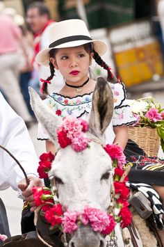 "A girl at the parade, dressed in a typical dress, at the ""Festival de las Flores"" in Medellin, Colombia."