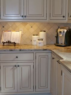 1000 ideas about white glazed cabinets on pinterest for Butter cream colored kitchen cabinets
