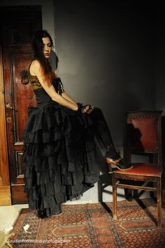 A moment in thought, after fastening the shoe... #gothic #steampunk #skirt #corset #lacing #brocade