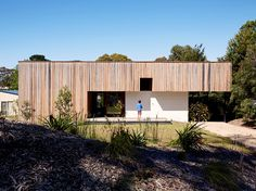 Rachel Nolan and Steven Farrell's weekend house is located a couple of blocks from the beach on Australia's Mornington Peninsula. Built with passive principles in mind, the low-slung structure features double-thick brick walls for thermal massing. House Cladding, Timber Cladding, Exterior Cladding, Cladding Ideas, Cement Design, Australian Architecture, House Architecture, Amazing Architecture, Weekend House