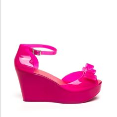 Jelly wedge with bow accent Jelly wedge with bow accent. Available in whole sizes only. New in box. Boutique brand available from shop nicety. Custom order takes one week to ship. ShopNicety Shoes Platforms