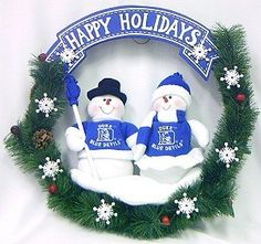 NCAA Snowman Christmas Wreath NCAA Team: Duke by SC Sports. $34.99. Officially licensed. 20 inches in size. Accented with pine cones and holly berries. Two snowmen dressed in official NFL team colors. 04121 NCAA Team: Duke Color/Finish: -Official NCAA team colors and logo. Specifications: -Dimensions : 20 H x 20 W.. Save 50% Off!
