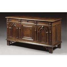 A PANELLED CHEST, CHARLES II, THIRD QUARTER 17TH CENTURY oak, with boarded cover, the front with arched, moulded panels and split baluster mouldings, the feet with pierced fret brackets, the interior with a till h.74cm., w.137cm., d.52cm.