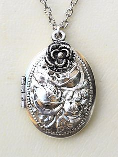 Measurements: silver plated locket. Locket is 1 1/8 long. Chain is 18 inches long. -----------------------------------------------