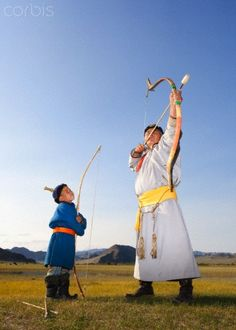 Archery in Mongolia. Father and Son dressed in traditional costume.