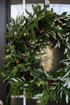 OLIVE-BRANCH WREATH from Birchlane ($179.00)  just added a few winter greens and some fake berries.
