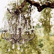 Gorgeous chandelier in the garden. What could be fancier...