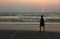 Child on the Beach - A child at the beach during sunset in Pollethai, India.
