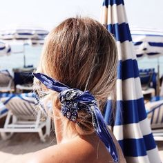 Bandanas tied in hair are timeless and perfect for summer.