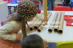 At play with marbles and tubes