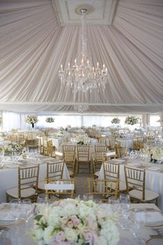 Gorgeous wedding drapery and table set-up. I like how some centerpieces are tall and others are short.