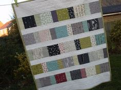 Green quilt made with charm packs