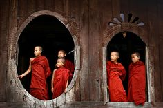 These novices are standing in the famous old teak wood Shwe Yan Pyay Monastery, near Inle Lake in Myanmar's Shan State. During Thingyan, the Burmese New Year, many Burmese boys celebrate shinbyu, a special rite of passage when a boy enters a monastery for a short time as a novice monk. They live the tough life of the monks: waking up early, washing with cold water and strict discipline. As the monks do, they have to buy their food with money given as alms. One meal a Day