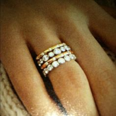 Eternity rings with simple gold stack. My favorite! Who says you need a man for a wedding ring?