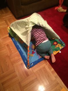 Hint Mama shares how to make a less messy fort and repurpose a baby product at the same time.