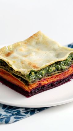Eating the rainbow is made easy with this multi-veggie lasagna made with beets, carrots, spinach and basil pesto.