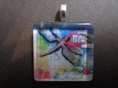 Another Handmade Glass Tile Pendant.  Made using a printed photo of my own artwork (a book collage).  Find at www.facebook.com/CSADesignsandmore