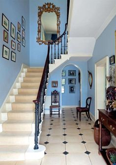 Grand staircase in Georgian town house - Sandy restored the handrail and balusters of the original staircase. The flooring is from Classical Flagstones of Bath and the walls are painted Lulworth Blue by Farrow & Ball
