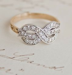 Bow Ring with Diamonds -A romantic bit of trivia: old mine diamonds were cut for candlelight, which makes them sparkle in even dim light.