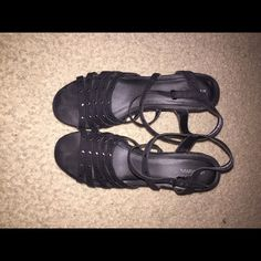 Black wedge heels Black wedge heels. Straps around the ankle. Size 11. Worn twice. Okay condition. Shoes Wedges