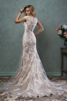 Wedding dress Pia - AmeliaSposa The lace is Gorgeous!