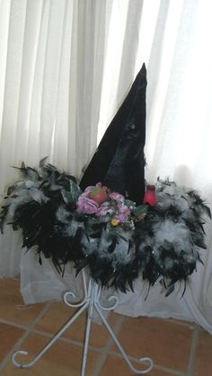 Handmade Very Special Black Witches Hat with Black and White Feathers Silk Flowers Faux Fruit Red Wood Rose. $125.99, via Etsy.